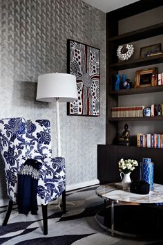 Study in Richmond home by Interior designer Christopher Elliott. Love that reupholstered chair in floral cobalt Ralph Lauren Fabric, love the sinuous rug and love love the graphic geometric silver wallpaper. Not convinced of them all in the same space though, especially with even more layering of patterns of the marble top and Aboriginal art. Thoughts?