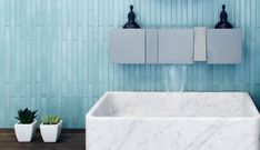 This large washbasin with slim edges is in white Carrara marble. Carrara comes wall mounted or countertop.