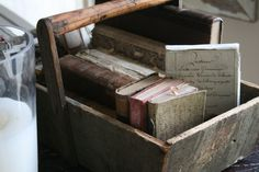 old books in a pail
