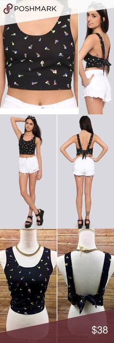 """Gupta Warrior Ice Cream Festival Bandana Crop Top Our favorite summer style that looks good enough to eat. Semi-sheer black crop top, featuring allover ice cream cone graphics, a wide scoop neckline, and thick ties at the back for an adjustable closure. Pair with our matching pants or keep it simple with your favorite distressed denim shorts.  Item Specifics:  Brand: Gypsy Warrior Color: Black New with Tags: Yes Materials: 100% Polyester  Sizing Info From Website: Bust: 32-34"""" approx Waist…"""
