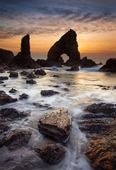 Sea arches form when waves erode through a headland or a stack. Here at Crohy head in Donegal is a fine set of sculpted rocks braving the Atlantic storms.