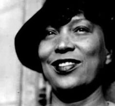 In 1918, Zora Neale Hurston began undergraduate studies at Howard University, where she became one of the earliest initiates of the Alpha Chapter of Zeta Phi Beta Sorority and co-founded The Hilltop, the University's student newspaper. While there, she took courses in Spanish, English, Greek and public speaking and earned an Associate's Degree in 1920.