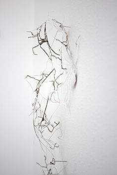 maps (2011) : sarah nance aa, mi, 2011 (detail) hand-cut paper 32 x 9 x 8 in.  http://sarahnance.com/selected-projects/maps-2011/IMG_3311-web.jpg