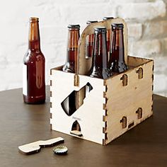 Laser-cut and engraved with an authentic burnished edge, the pieces ship flat… Drink Holder, Bottle Holders, Beer Caddy, Utensil Caddy, Gravure Laser, Unique Candle Holders, Laser Cutter Projects, Wood Gifts, Cool Gadgets