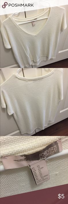 Forever 21 Short Sleeve Knit Sweater Forever 21 contemporary knit sweater. Creamish/off white color. Size XS. Fits more like a size M. Super soft and a good basic for spring/fall. Never worn. Willing to sell as a bundle with my other forever 21 tops listed! Forever 21 Tops Tees - Short Sleeve