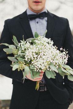 A man bringing flowers..
