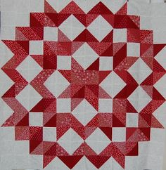 "HSTs! The blogger says this finishes around 50"" square. Tickle out the layout and use your HSTs to make the the quilt finish to the size of your choice."