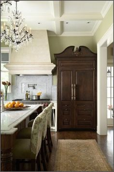 Beautiful wardrobe in the kitchen. Perhaps disguising a refrigerator or pantry.