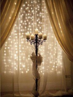 Last minute Christmas décor: lights hanging from a curtain rod behind a sheer curtain.                                                                                                                                                      More