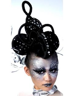 Very stylized look accented by a lot of  crystals and a lot of hair.