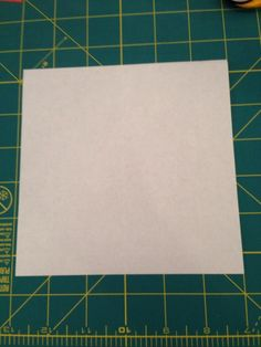 With the white side up, valley fold the paper in half horizontally, vertically, and diagonally. Unfold,