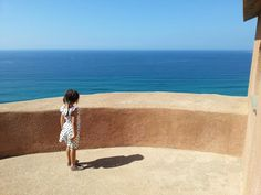 Bella on top of the Spanish Torre of San Giovanni. Tharros, Sardinia.  Italy 2014