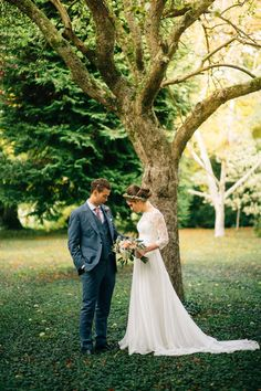 Katie wore a bespoke gown by London based designer Shanna Melville for her romantic Autumn wedding in the Cotswolds. Photography by Joseph Hall.