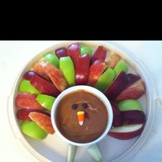 Thanksgiving appetizer! Apples and caramel dip turkey. Carmel dip recipe: microwave 3/4 cup brown sugar and 1/2 stick butter for 1 min at a time up to 3 min until bubbly. Stir in 1 tsp vanilla and 8 oz. cream cheese (softened).