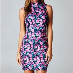 Navy Floral And Mesh Dress Super cute navy and pink floral dress! It features two side mesh cut outs as well as two buttons on the back neck! -Message me for lower ️️ price Cecil Lee Dresses