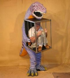 awesome dinosaur & human in cage costume.