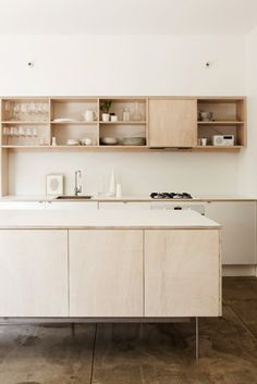 plywood + open shelving + white walls
