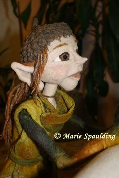 Needle felted elf doll by Marie Spaulding.  Needle felted body made of CW-1 Core Wool and MC-1 Felting Batts. Acorn hat is wet felted and needle felted, tunic is nuno felted.