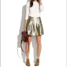 """Madewell shimmer skirt Brand new with tags Madewell Shimmer Skirt in metallic gold size 8  Shimmery fabric paired with inverted pleats. An easy party-night pick.  •Full mini. •17 1/2"""" long. 16"""" at waist •Poly/metallic threads. •Dry clean. Madewell Skirts"""