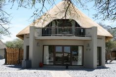 Chalets around the waterhole are delightful. Round House Plans, My House Plans, Cottage House Plans, Cottage Homes, Thatched House, Thatched Roof, Hexagon House, African Interior Design, House Plans South Africa