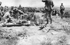 When the shooting had to stop ... Anzacs and Turks work together to bury the dead on May 24, 1915.  Photo: Phillip Schuler. AWM/PS1670