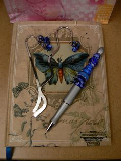 pen and bookmarks with lampwork beads -