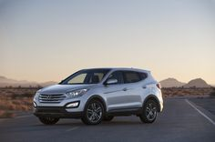 The 2013 Hyundai Santa Fe splits its identity in two: the three-row ute goes V-6 only, while the five-passenger Sport leans on turbo power, a flexible second-row seat and a cushy ride to make its best case ever.    Read More Here: http://www.thecarconnection.com/overview/hyundai_santa-fe_2013