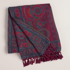 You'll love our exclusive, 100% cotton throw on cozy nights in. Woven in India on a jacquard loom, this blanket's rich jewel tones add a stunning look to any sofa, chair or bed.