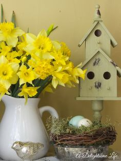 A DELIGHTSOME LIFE spring vignette daffodil bouquet mercury glass bird birdhouse and nest