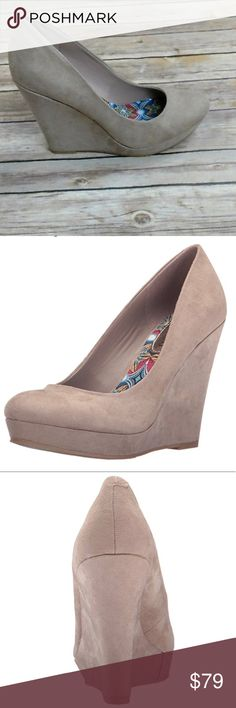 "Taupe Micro Suede Wedge Taupe color round-toed wedge. Micro Suede Imported Heel measures approximately 4"" Platform measures approximately 0.75 inches Round toe high heel wedge pump Monotone Wedge by Madden G Steve Madden Shoes Wedges"