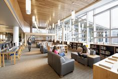 The library at Shorewood HS is filled with natural light thanks to a wall of windows.