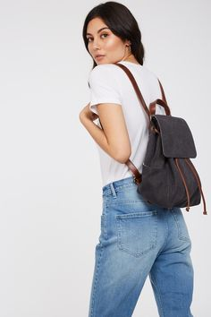 The Eddie Leather Trim Backpack is perfect for all your summer expeditions. Its simple, classic and roomy creating a timeless look. Introducing Elementary - relaxed, timeless silhouettes in natura In Natura, Canvas Leather, Simple Living, Silhouettes, Saddle Bags, Organic Cotton, Fabrics, Backpacks, Pockets