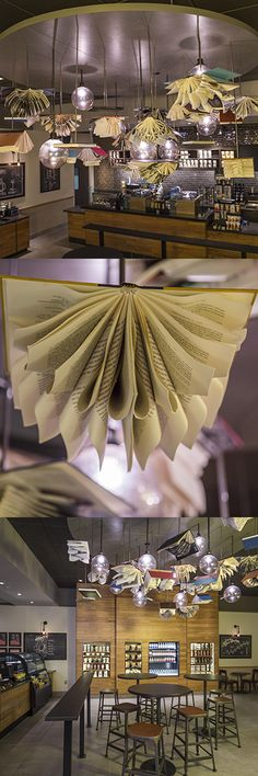 """Inspired by the school's science program, our George Mason University store highlights the """"science of coffee"""" with chalkboards and """"Flying Books"""" artwork. The installation includes 34 reclaimed books from the university's library."""