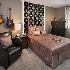 Headboard idea and electric guitars on wall