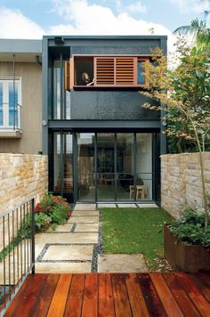Urbis Magazine (Topsy-Turvey House) Nice use of sliding, operable louvres!