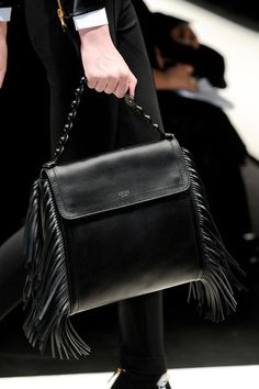 Moschino fringe bag spotted on the runway. Take this summer trend into fall and winter with the dark black.