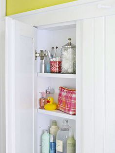 Medicine cabinet above toilet: We'll sink a shallow shelving unit into the wall and hide it behind a bead board door for a seamless look.