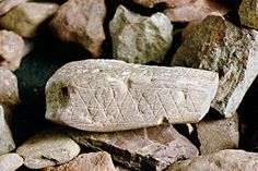 First Writing - inscribed ochre fragment, 77,000 ybp, Blombos Cave, South Africa.  Because the patterns are highly regular and not random, anthropologists are confident they encode information (Sci Am, Sept 2014).  (Not being artists, they failed to account for the thrill of creating simple decoration, that had to arise sometime in the past.  TD)