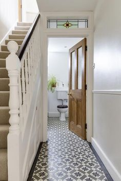 Chelsea encaustic tiles from Ca' Pietra. Pattern tiles in the hallway. Chelsea encaustic tiles from Ca' Pietra. Pattern tiles in the hallway. Chelsea encaustic tiles from Ca' Pietra. Pattern tiles in the hallway. Blue Hallway, Tiled Hallway, 1930s Hallway, Victorian Hallway Tiles, Style At Home, Hall Tiles, Hall Flooring, Flur Design, Hallway Inspiration