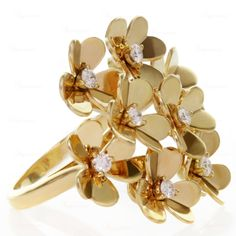 VAN CLEEF & ARPELS Frivole Diamond 8 Flower Gold Ring | From a unique collection of vintage cluster rings at http://www.1stdibs.com/jewelry/rings/cluster-rings/