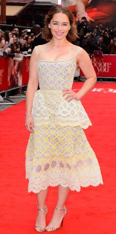 How pretty! Emilia Clarke was radiant at the Me Before You London premiere in a lemony yellow hand-knit Yelets lace Ulyana Sergeenko Couture peplum design with metallic Jimmy Choo sandals.