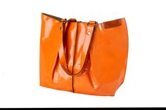 Orange patent shoulder bag. Can be used as handbag or beach bag. Internal bag can be used inside as a compartment or removed and used as a clutch of shoulder / cross body bag using the long strap provided. Comes in orange, purple, blue, fuschia pink, pale pink and green. Sold by Love Viva. https://www.facebook.com/LoveVivaaccessories