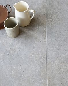 porcelain tile floor Pebble Grey porcelain stone tiles available in for floor tiles. Order your FREE sample of Pebble Grey porcelain stone tiles today! Grey Kitchen Tiles, Grey Tiles, Grey Floor Tiles Bathroom, Stone Tile Flooring, Grey Flooring, Concrete Tiles Floor, Stone Look Tile, Stone Tiles, Pebble Tiles