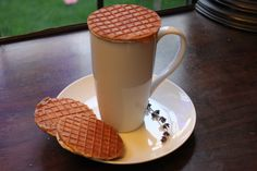 Traditionally, Dutch Stroopwafels are placed on your coffee cup to heat them through. The steam from the coffee heats and warms the caramel in the center. We love it!