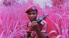 A young soldier from the Mai Mai Yakutumba militia group poses at a secret location near Lake Tanganyika, South Kivu, Eastern Congo, 2012.