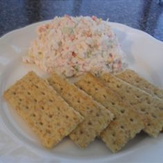 This is a cold crab dip recipe that is made with immitation crab meat. Being from Maryland, I know there is nothing like real Blue Crab chunks, but lets face it.. it's expensive. I made this recipe up because I was tired of buying pre-made crab dips in the store and constantly being dissatisfied with the flavor. I hope you enjoy this easy Poor Man's Crab Dip. - Poor Man's Crab Dip