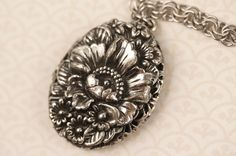 Hey, I found this really awesome Etsy listing at http://www.etsy.com/listing/166555413/silver-flowers-filigree-locket-necklace