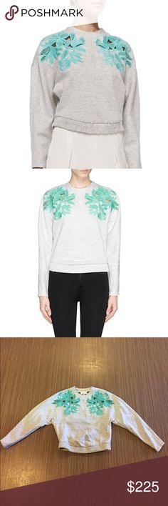 3.1 Phillip Lim Guipure Lace Appliqué Sweatshirt Designed in a unique style, this Phillip Lim sweatshirt is stylish and calm. It's grey exterior is designed with Guipure lace applique on the sides, long sleeves and a round neckline. The bottom is lined with a ribbed hem. Condition: Like New 3.1 Phillip Lim Tops Sweatshirts & Hoodies