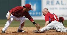 Houston Astros second baseman Jose Altuve almost makes the tag...