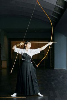 Player of kyudo aiming at the mark